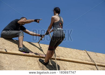 A Man Is Helping A Woman At A Competition