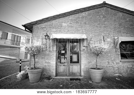 The facade of the old shop. The survey was conducted in the infrared range. It turned out a classic black and white photo.