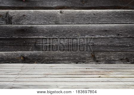 Free Space Above The Wooden Surface Against The Background Of A Dark Wooden Wall