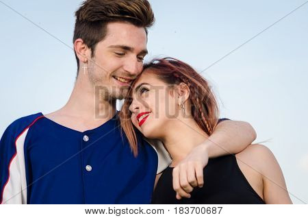 Beautiful young couple in love hugging on outdoor