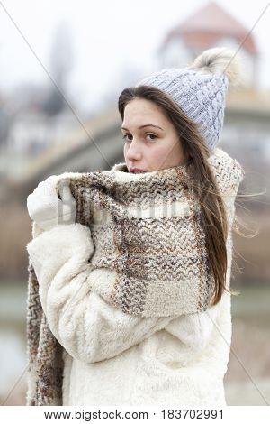 Portrait Of A Young And Beautiful Woman  With Cap And Scarf In Winter