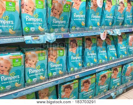 Nowy Sacz Poland - April 26 2017: Different types of Pampers active baby-dry by Procter & Gamble Co. and offered for sale in E.leclerc Supermarket.