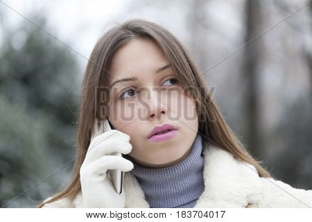 Young Pensive And Worried Woman Phoning