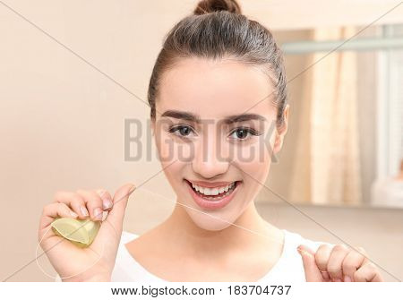 Beautiful woman brushing teeth in bathroom