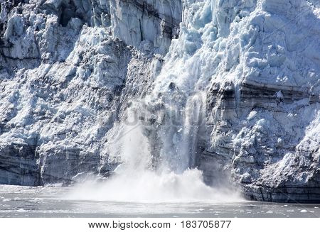 The ice of a glacier falling down in Glacier Bay national park (Alaska).