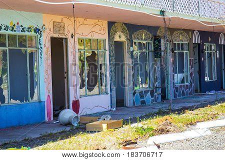 Abandoned Motel Units Vandalized With Broken Windows & Trash