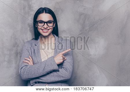 Horizontal Portrait Of Young Attractive Smiling Woman In Glasses And Formalwear Standing With Crosse