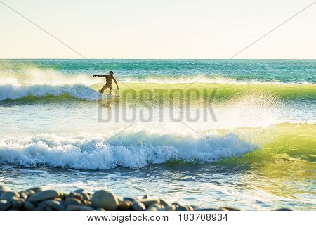 Surfing in the spring. Clear waves and surfer in ocean