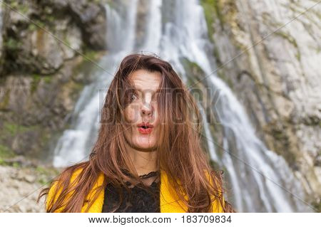 Beautiful long hair woman emotional portrait on natural background