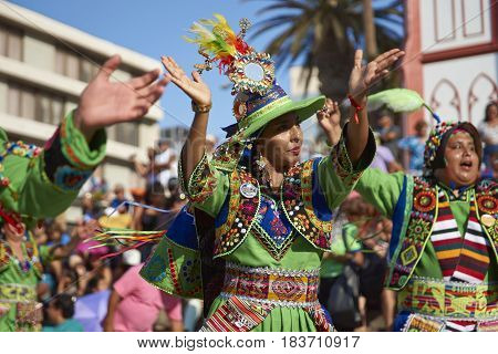 ARICA, CHILE - FEBRUARY 11, 2017: Tinkus dancers dressed in ornate costumes performing during a street parade at the annual Carnaval Andino con la Fuerza del Sol in Arica, northern Chile.