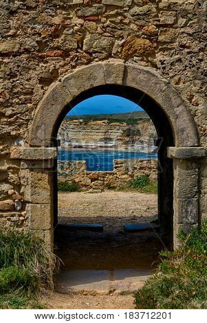 Ancient door leaving to a wonderful landscape