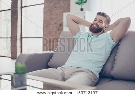 Single Happy Young Man Is Relaxing On The Sofa At Home. He Is Dreaming About Vacation, That Is Comin