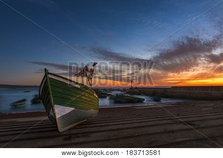Traditional wood fishing boat in the harbour at the coastal town of Souira Kedima in Morocco; Concept for travel in Morocco