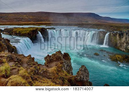 Water going down on Godafoss waterfall in Iceland