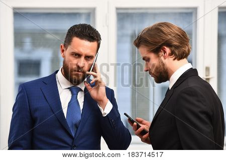 Office Workers Talking By Phone. Business Concept
