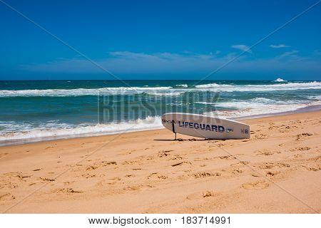 Wollongong Australia - December 26 2016: Lifeguard surfboard on ocean beach on sunny day
