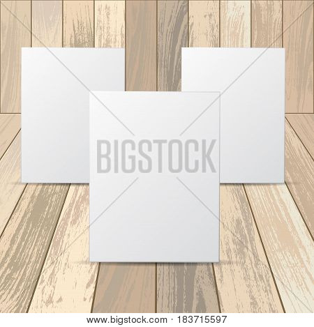 Set of three white frames with isolated on wooden background