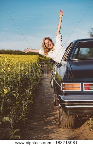 Carefree woman enjoy road trip.