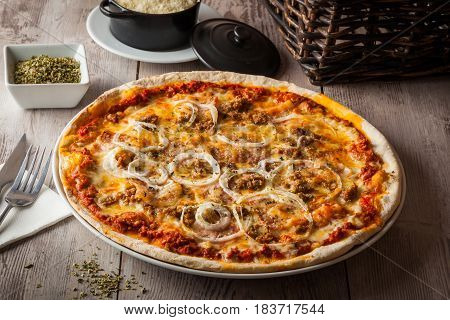 Barbecue pizza with tomato cheeseground meat onions and barbecue sauce.