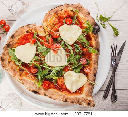 A heart shaped pizza made specially for Valentine's day.