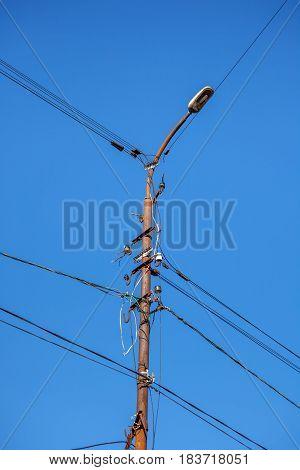 Mast Electrical Power Line Against Blue Sky