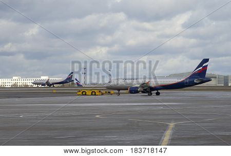 MOSCOW, RUSSIA - APRIL 15, 2015: Two Airbus A320 of Aeroflot at airfield. Sheremetyevo