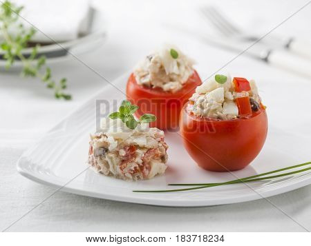 Tomatoes stuffed with a mixture of cod and vegetables.