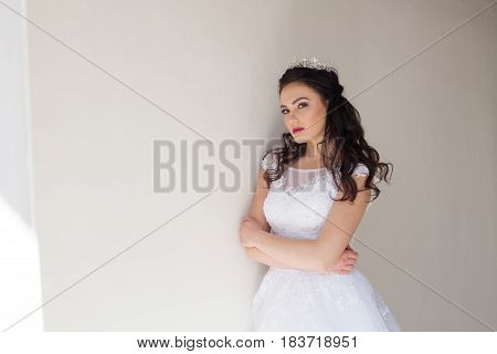 Princess with a Crown in white dress the bride brunette