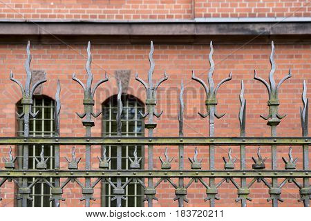 Wrought Iron Fence In Front Of A Red Brick Building