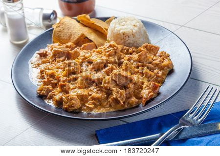 Mexican food: Chipotle Cream Chicken served with rice and nachos.