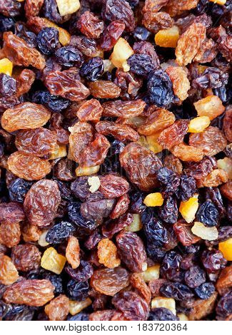 Colorful mixed vine fruit including raisins and sultanas with candied peel. Space for text.