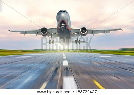 Aircraft speed on the landing runway at dawn.