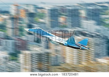 Fighter jet plane over the city at high speed.