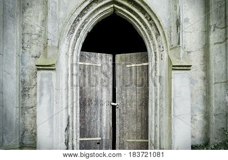 old weathered gothic entrance of a tomb