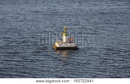 Warning floating buoy indicates the underwater sea cabel way (Kabel means Cable)