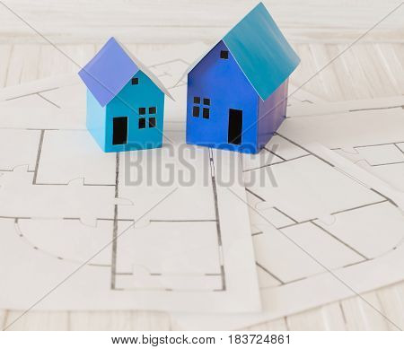 the blue paper houses on wooden table