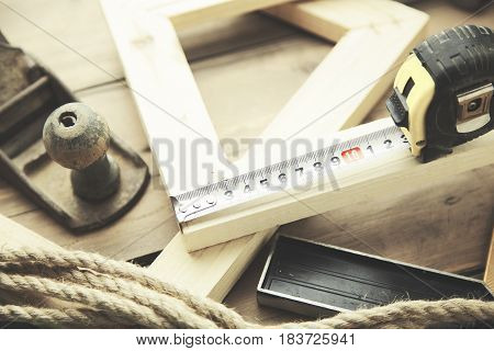 Artist canvas canvas stretcher and staple gun on table