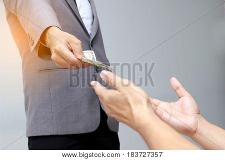 Business Man Pay Dollar For Homeless Hands,us Dollar Bills