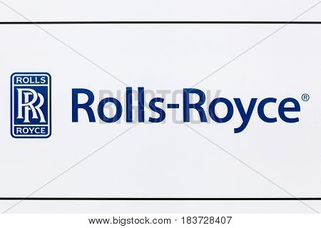 Hirtshals, Denmark - June 28, 2015: Rolls Royce logo on a wall. Rolls-Royce Limited owned a British luxury-car and aero engine manufacturing business founded in 1904