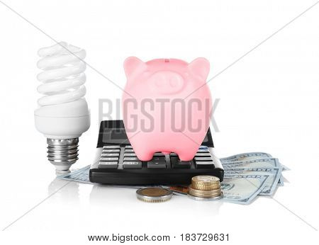 Cute piggy bank with money and bulb on white background
