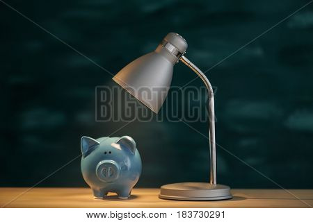 Piggy bank on illuminated surface under lamp
