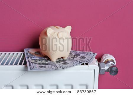 Cute piggy bank and money on pink background