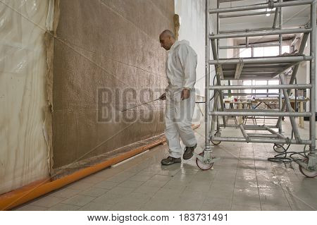 man doing a fresco treatment with spray
