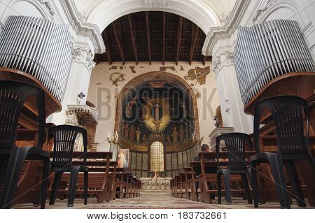 SALERNO ITALY - APRIL 23 2017: Baroque interior of San Matteo cathedral the altar and the mosaic on the apse