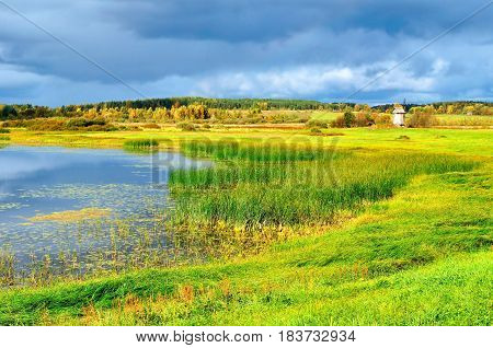 Autumn landscape -autumn view of Malenets lake in Pushkinskiye Gory Russia - autumn natural landscape of autumn nature in sunny autumn weather. Autumn colorful landscape of autumn nature
