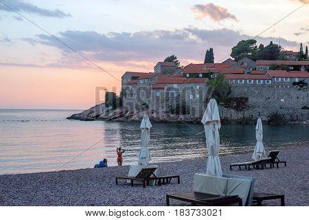 Evening on the beach Sveti Stefan in Montenegro