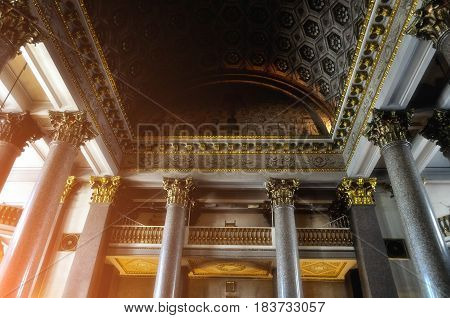 ST PETERSBURG RUSSIA - AUGUST 4 2015. Decorative elements -columns and sculptural ceiling -in the interior of Kazan Cathedral in St Petersburg Russia