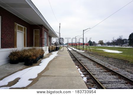 KALKASKA, MICHIGAN / UNITED STATES - NOVEMBER 27, 2016: The loading platform of the historic Train Depot is now the back of the Kalkaska Historical Museum in downtown Kalkaska.