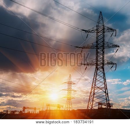 Electricity pylon with after rain sky. High voltage electric tower with beautiful sky background after the rain.