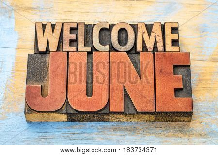 Welcome June banner - word abstract in vintage letterpress wood type blocks